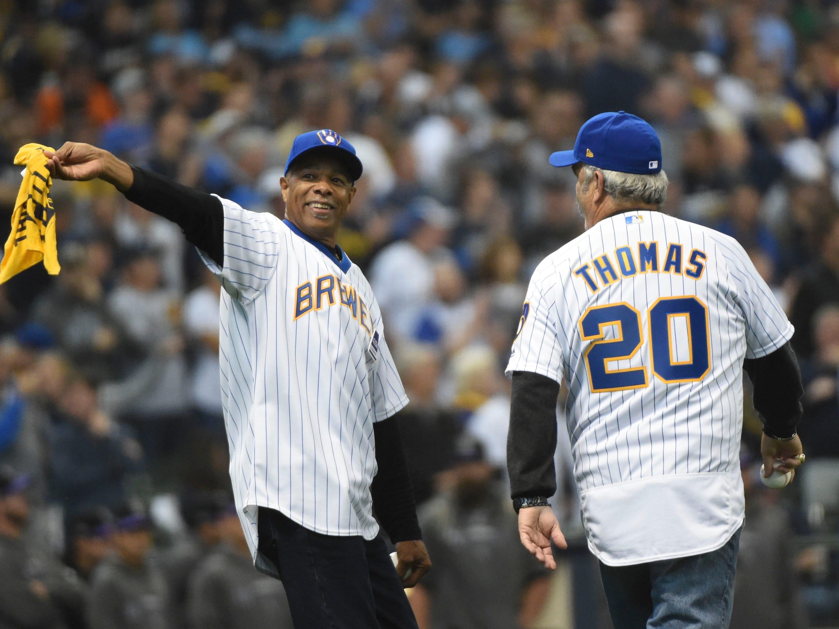 NLDS Game 2: Former Brewers players Cecil Cooper (left) and Gorman Thomas throw out the ceremonial first pitch.