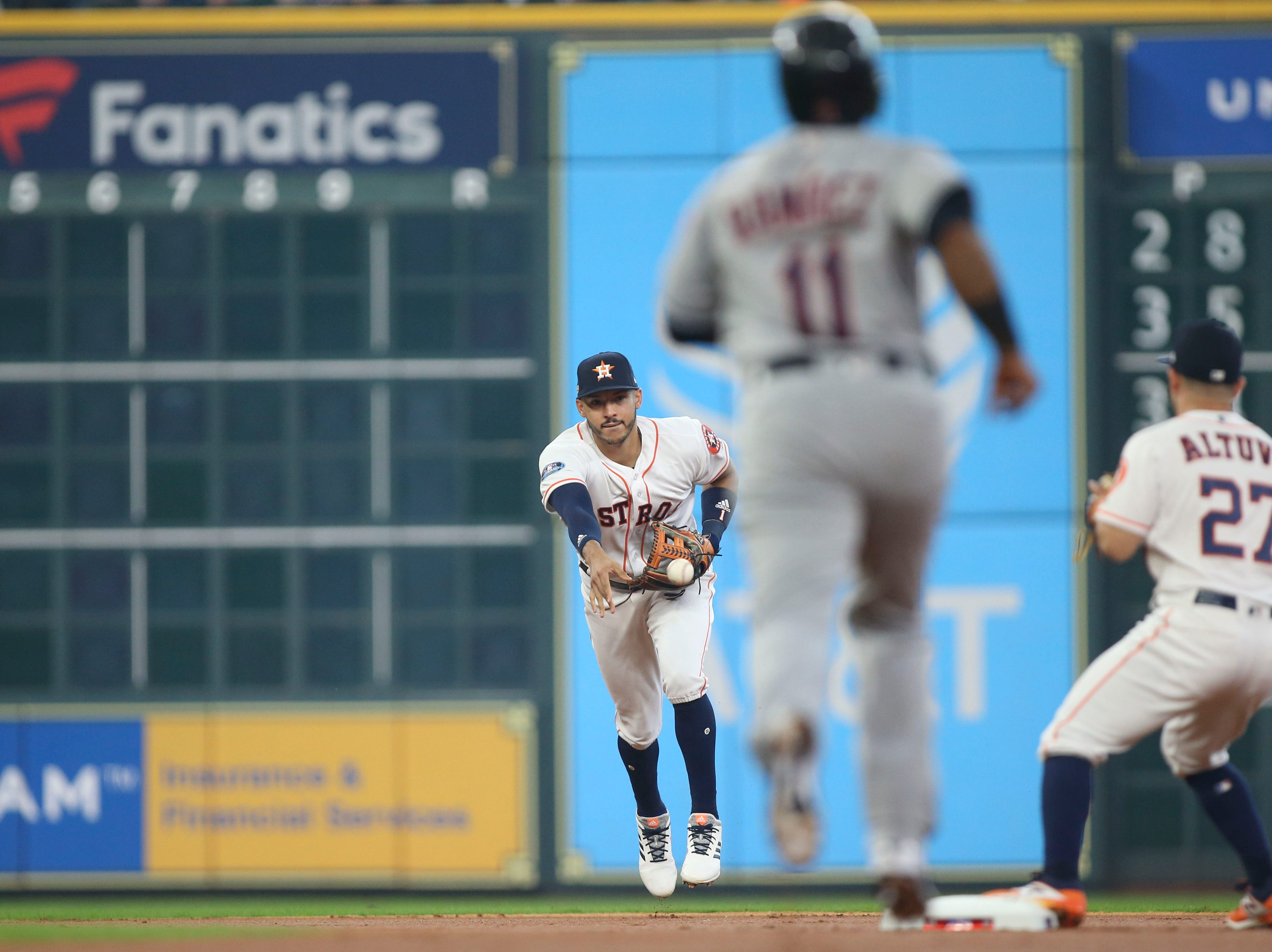 ALDS Game 1: Astros shortstop Carlos Correa flips the ball to second baseman Jose Altuve for an out in the first inning.