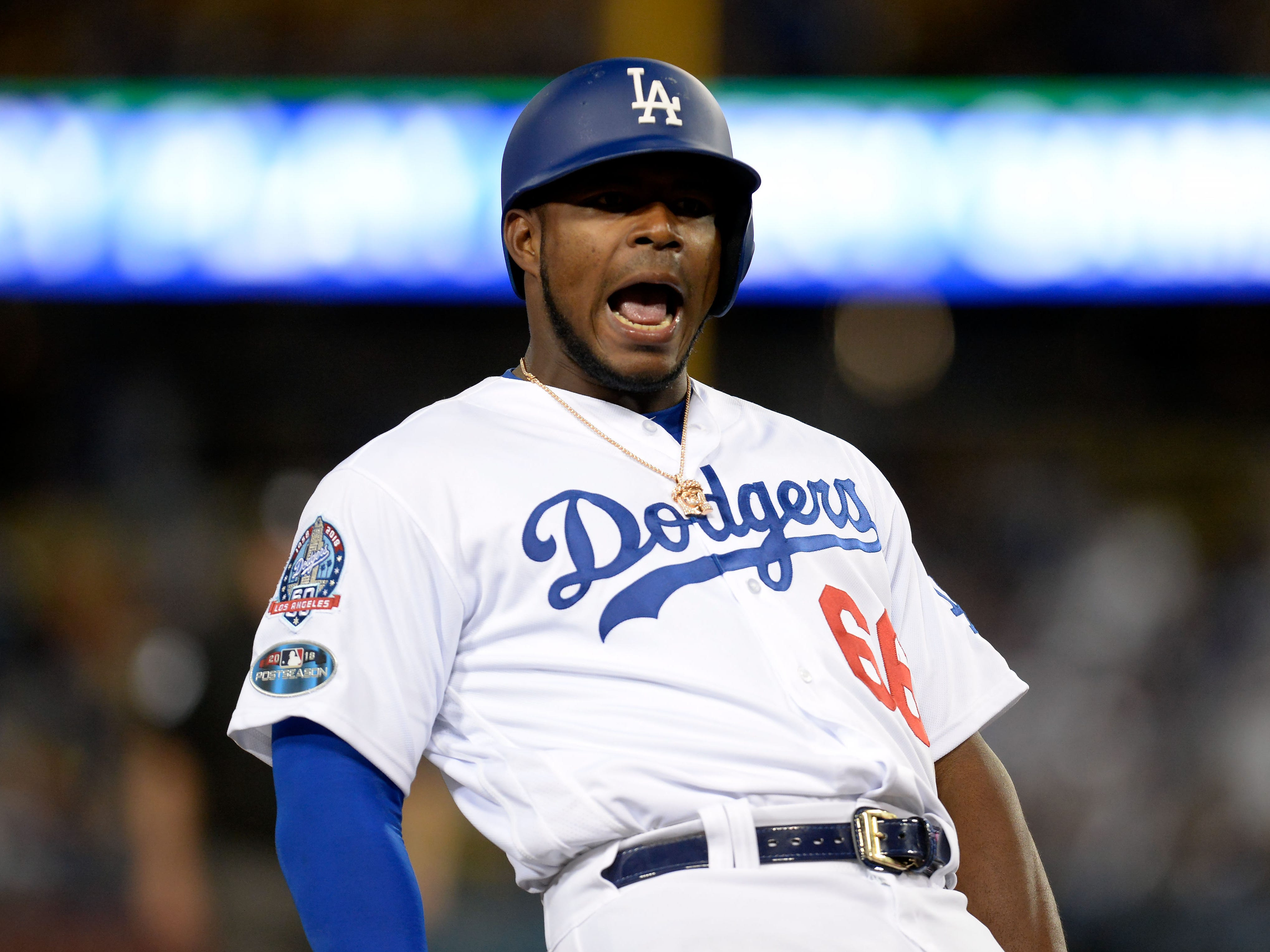 NLDS Game 1: Dodgers right fielder Yasiel Puig reacts after reaching third base on a throwing error in the eighth inning.