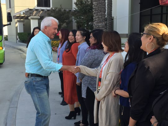 California gubernatorial candidate John Cox, a Republican, introduces himself to workers at Huy Fong Foods in Irwindale, Calif.