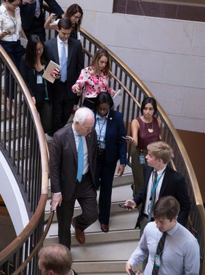 Senate Majority Whip John Cornyn, R-Texas, center left, speaks to reporters as he heads to a secure underground room in the Capitol to see a new FBI background file on sexual allegations that have been made against Supreme Court nominee Brett Kavanaugh, in Washington on Oct. 4, 2018.