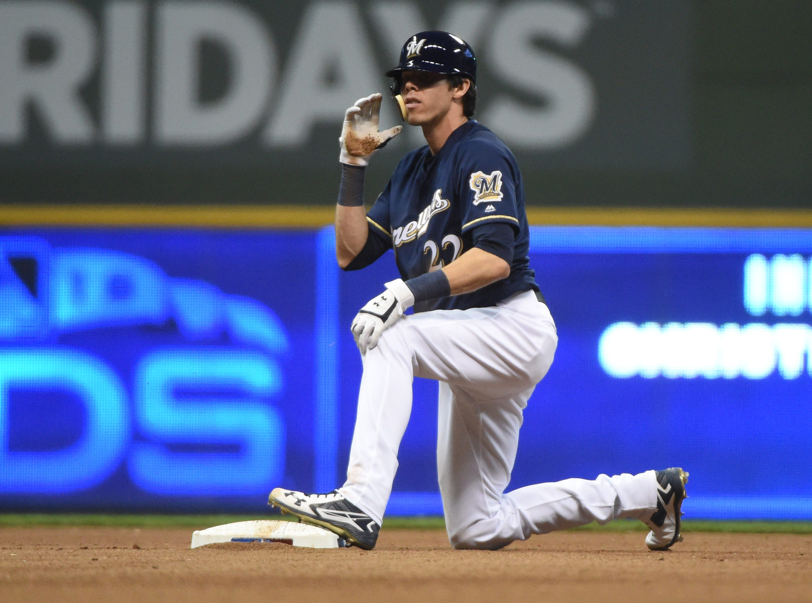 NLDS Game 1: Christian Yelich reacts after stealing second base in the eighth inning.