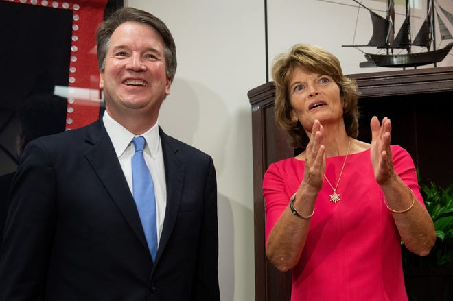 Sen. Lisa Murkowski, right, Republican from Alaska, speaks with Supreme Court associate justice nominee Brett Kavanaugh in Washington, D.C.,  on Aug. 23, 2018.