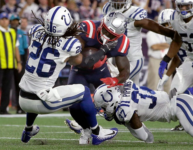 Colts S Clayton Geathers (26) gets run over by Patriots RB Sony Michel on Thursday night.