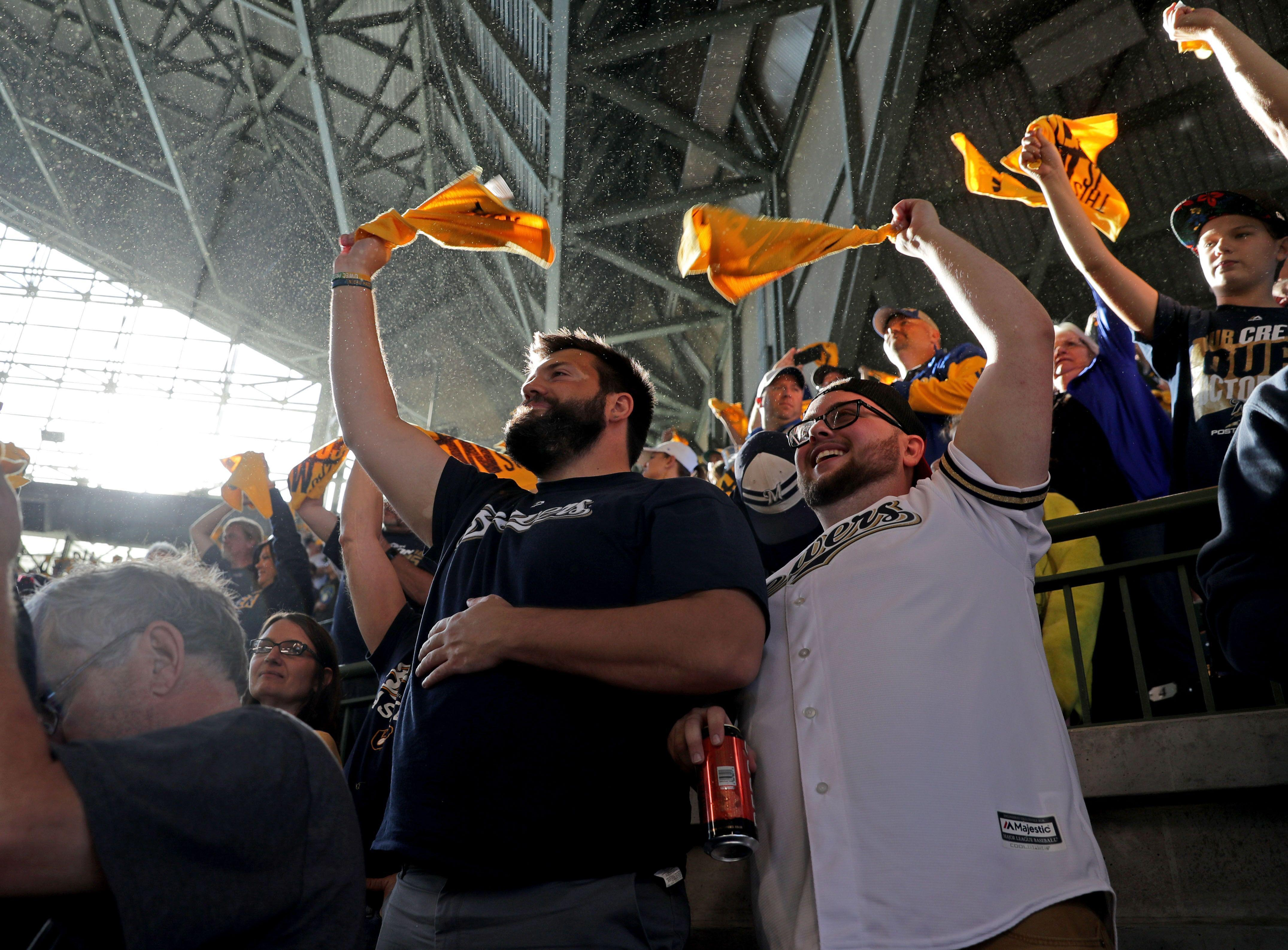 Oct 4, 2018; Milwaukee, WI, USA; Milwaukee Brewers fans Mathew Riedel (left) and Hunter Halverson wave rally towels during in game one of the 2018 NLDS playoff baseball series against the Colorado Rockies at Miller Park. Mandatory Credit: Mike De Sisti/Milwaukee Journal Sentinel via USA TODAY Sports ORG XMIT: USATSI-389881 ORIG FILE ID: 20181004_jla_bs5_098.jpg