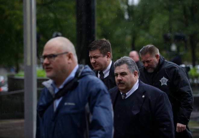 Chicago police officer Jason Van Dyke (center) arrives at the Leighton Criminal Courts Building in Chicago. He was found guilty of second-degree murder Friday in the 2014 shooting death of 17-year-old Laquan McDonald.