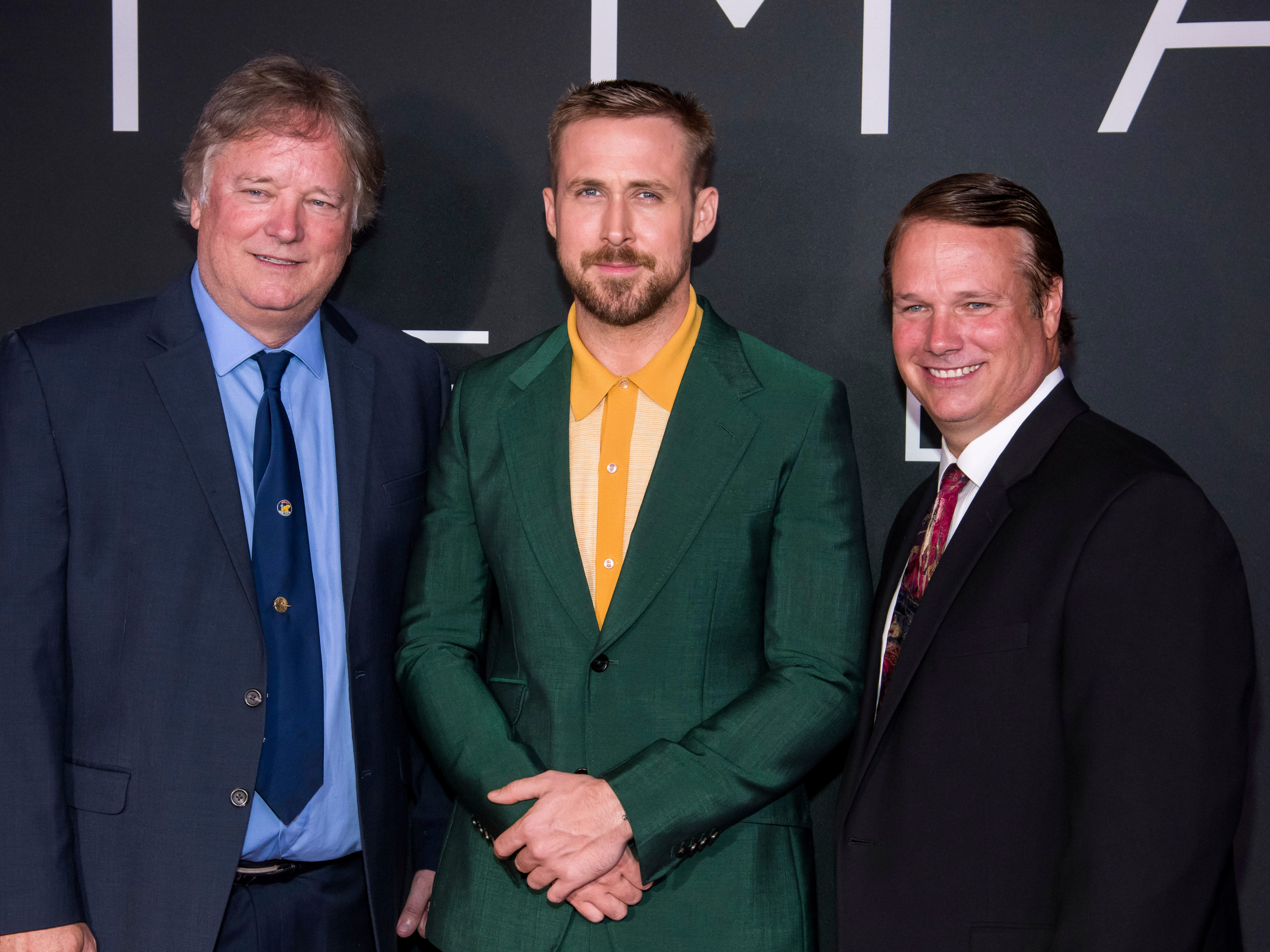 """Rick Armstrong, left, Ryan Gosling and Mark Armstrong attend the """"First Man"""" premiere at the National Air and Space Museum of the Smithsonian Institution on Thursday, Oct. 4, 2018, in Washington. (Photo by Charles Sykes/Invision/AP) ORG XMIT: NYCS113"""