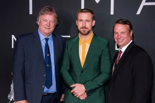 "Rick Armstrong, left, Ryan Gosling and Mark Armstrong attend the ""First Man"" premiere at the National Air and Space Museum of the Smithsonian Institution on Thursday, Oct. 4, 2018, in Washington. (Photo by Charles Sykes/Invision/AP) ORG XMIT: NYCS113"