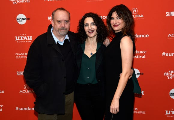 "Tamara Jenkins, center, director of ""Private Life,"" poses with cast members Paul Giamatti, left, and Kathryn Hahn at the premiere of the film on the opening night of the Sundance Film Festival on Thursday, Jan. 18, 2018, in Park City, Utah. (Photo by Chris Pizzello/Invision/AP) ORG XMIT: UTCP126"