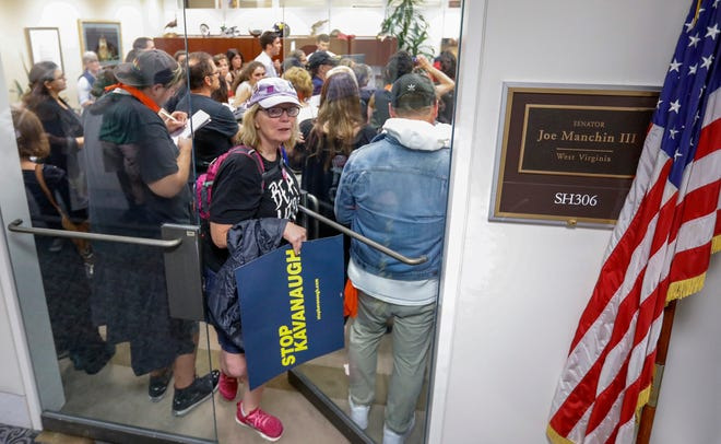 Protestors, including Sara Thomsen, crowd the office of Democratic Senator from West Virginia Joe Manchin, on Oct. 5, 2018,  after a vote to advance the confirmation process of Supreme Court nominee Judge Brett Kavanaugh in Washington, DC.
