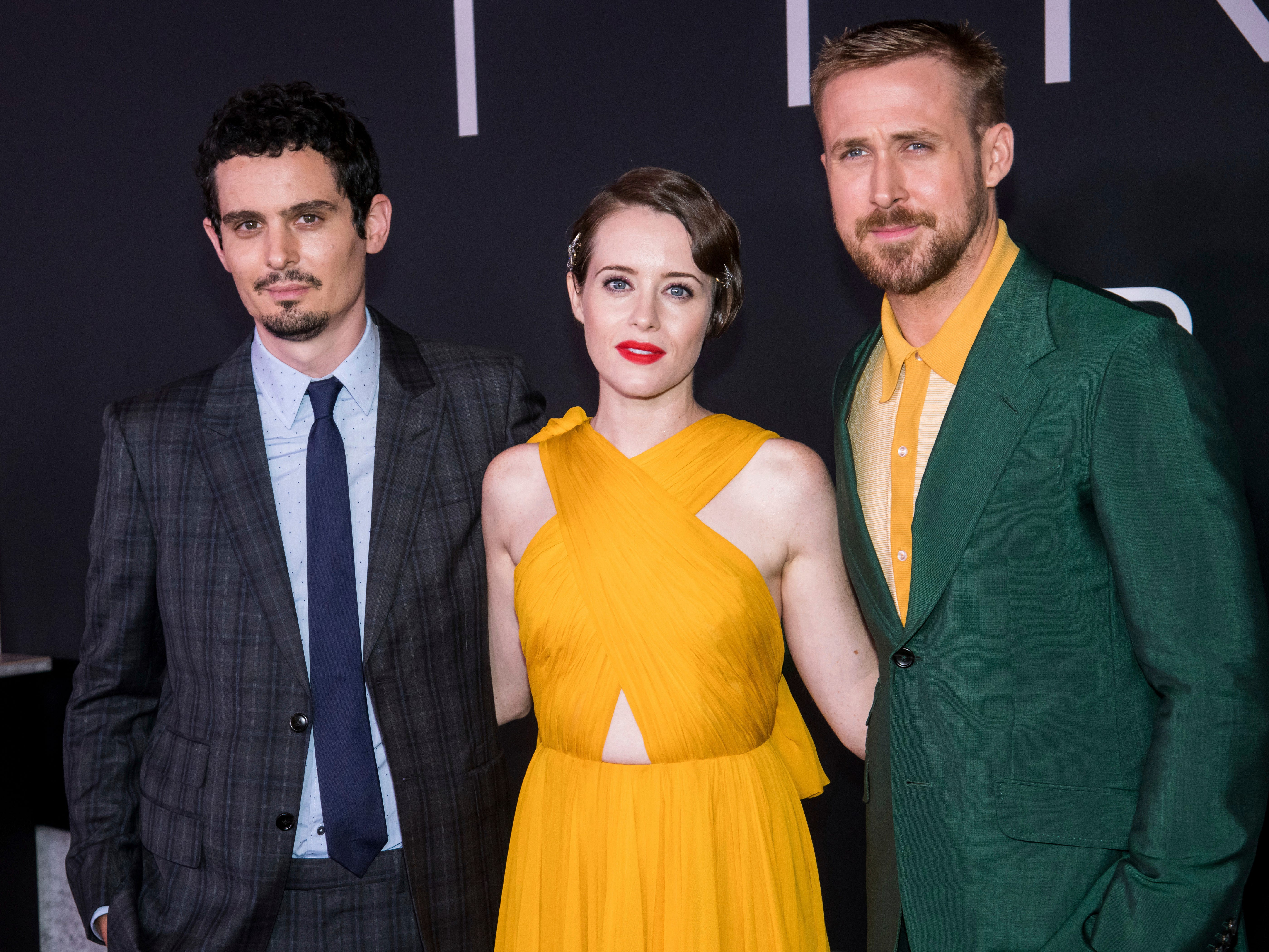 """Damien Chazelle, left, Claire Foy and Ryan Gosling attend the """"First Man"""" premiere at the National Air and Space Museum of the Smithsonian Institution on Thursday, Oct. 4, 2018, in Washington. (Photo by Charles Sykes/Invision/AP) ORG XMIT: NYCS109"""