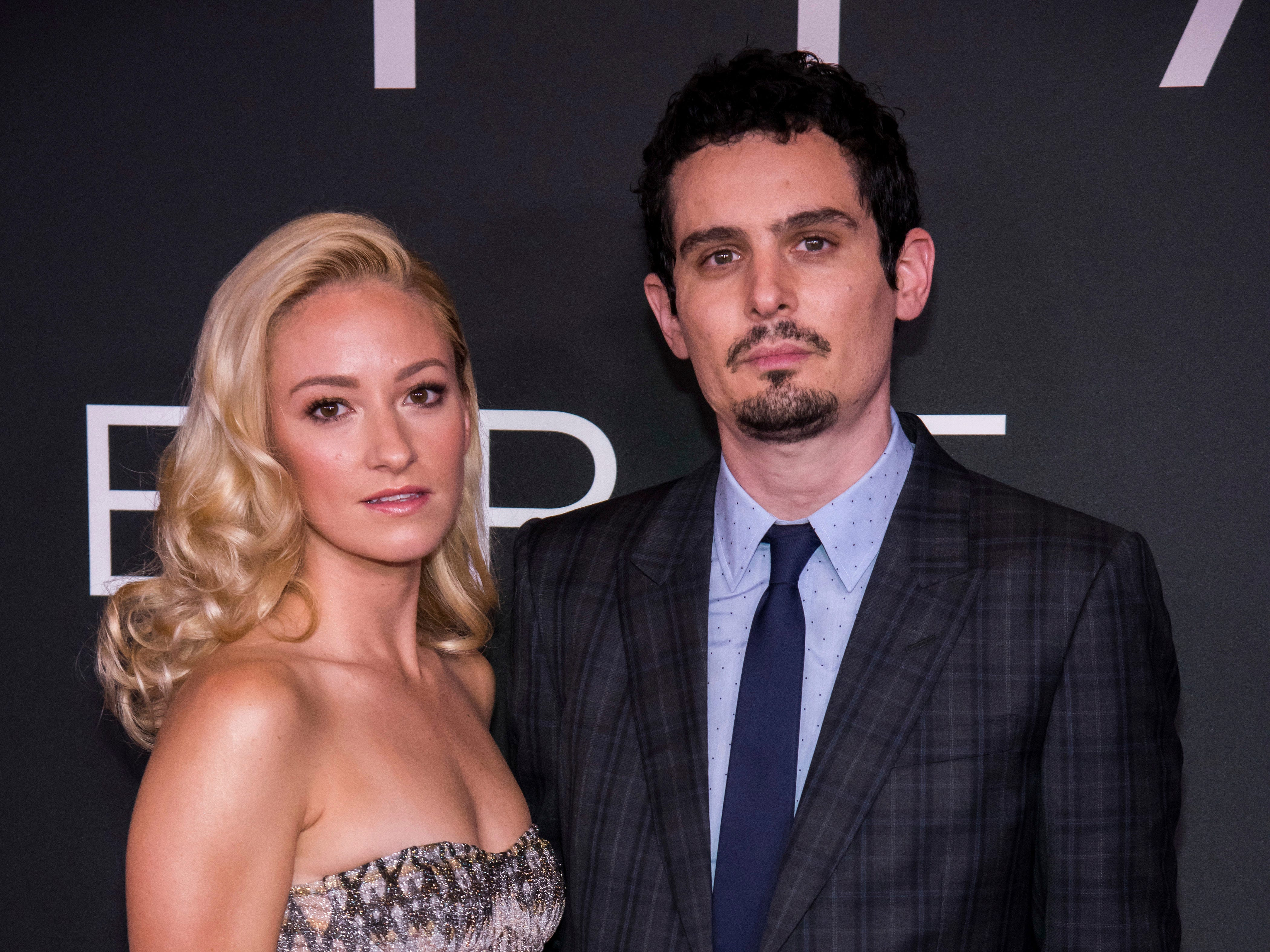 """Olivia Hamilton and Damien Chazelle attend the """"First Man"""" premiere at the National Air and Space Museum of the Smithsonian Institution on Thursday, Oct. 4, 2018, in Washington. (Photo by Charles Sykes/Invision/AP) ORG XMIT: NYCS102"""