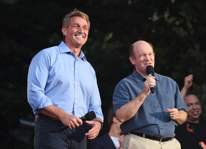 Sen. Jeff Flake, R-Ariz., left, and Sen. Chris Coons, D-Del., address the crowd at the 2018 Global Citizen Festival in Central Park on Saturday, Sept. 29, 2018, in New York.
