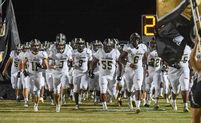 Easley High School runs on the field for th game with Clemson October 25.