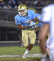 DW Daniel senior Kiandre Sims(5) runs against Wren during the fourth quarter at D.W. Daniel High School in Central on Friday, October 5, 2018.