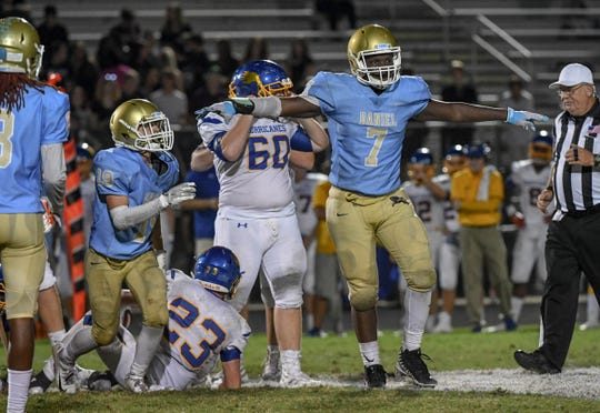 DW Daniel junior Jared Kirksey(7) reacts after tackling Wren senior Daniel Taffer (23) during the fourth quarter at D.W. Daniel High School in Central on Friday, October 5, 2018.