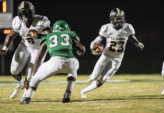 TL Hanna senior Isaiah Norris runs near Easley juior Josh Hill(33) during the first quarter at Easley High School on Friday, October 5, 2018.