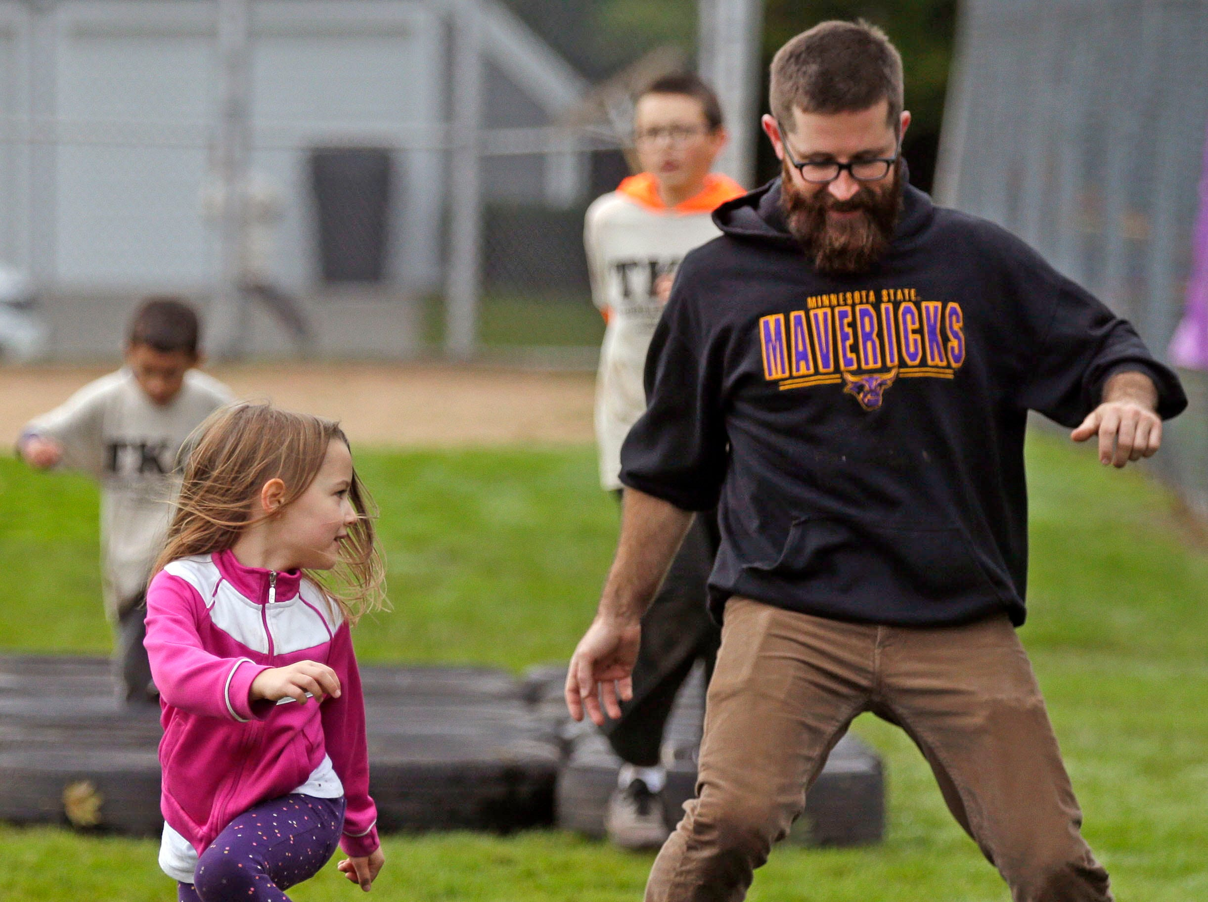 Evelyn Daily keeps an eye on her father, Nate, as they tackle an obstacle during the Essity Fox Valley Tough Kid Challenge Saturday, October 6, 2018, at Highlands Elementary School in Appleton, Wis. The event raised funds for Physical Education Departments in Appleton.