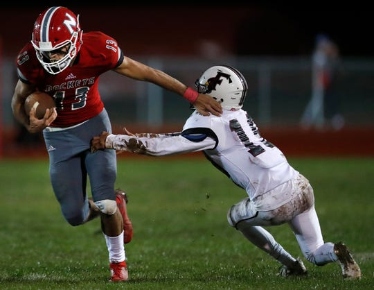 Neenah's Logan Morrow pushes past Fond du Lac's Julian Murillo on Friday. Danny Damiani/USA TODAY NETWORK-Wisconsin