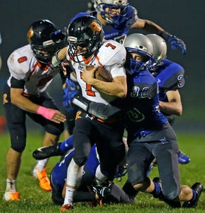 Michael Navis of Cedar Grove-Belgium carries the ball against Hilbert in a game for the Big East Conference title Friday, October 5, 2018, at Hilbert High School in Hilbert, Wis.Ron Page/USA TODAY NETWORK-Wisconsin