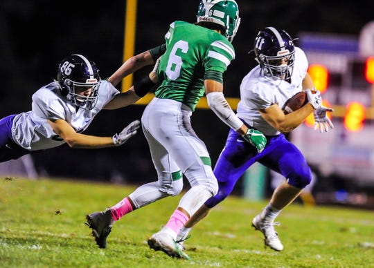 Rumson Fair Haven's Andrew Lawless tries to outrun Shane Williams of Brick with the help of teammate Patrick Jamin, (85) during a  game in Brick on Oct. 5, 2018.