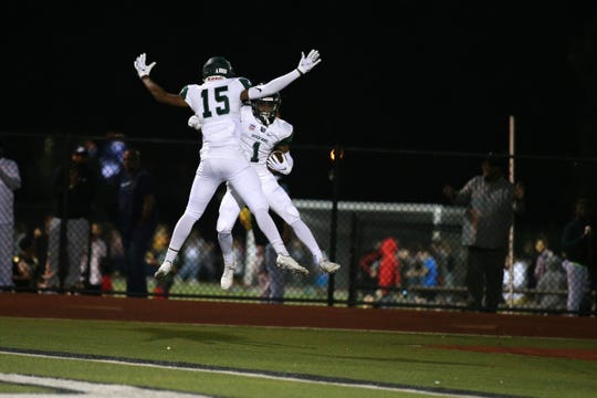 Long Branch's Jayon Farrar celebrates a touchdown during the second half of the Long Branch at Red Bank Catholic Red Zone Game of the Week at Count Basie Field in Red Bank, NJ Friday, October 5, 2018.