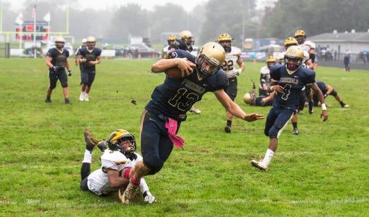 Freehold quarterback Matt Krauss scores one of third quarter touchdowns. St John Vianney Football vs Freehold Boro in Freehold, NJ on October 6, 2018.
