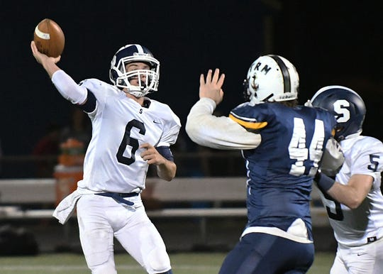 Middletown South's QB Trevor Brey looks to pass as Middletown South Football takes on Toms River North on 10/5/2018