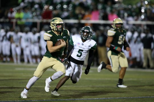RBC's quarterback Steve Lubischer runs the ball for a touchdown during the second half of the Long Branch at Red Bank Catholic Red Zone Game of the Week at Count Basie Field in Red Bank, NJ Friday, October 5, 2018.