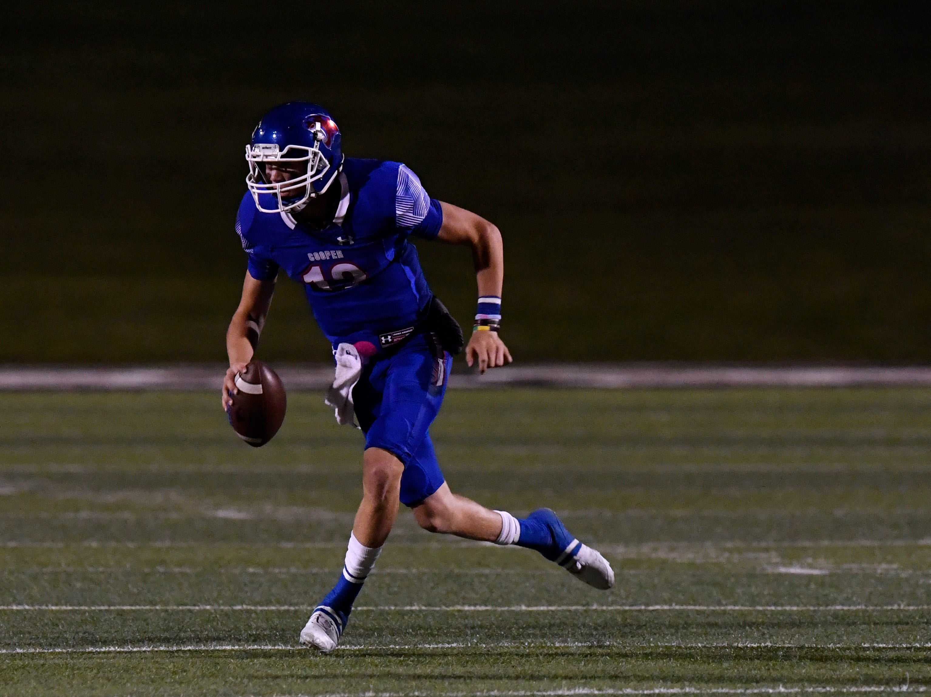 Cooper quarterback Aidan Thompson looks for someone to throw to during a District 4-5A game against Lubbock Coronado.