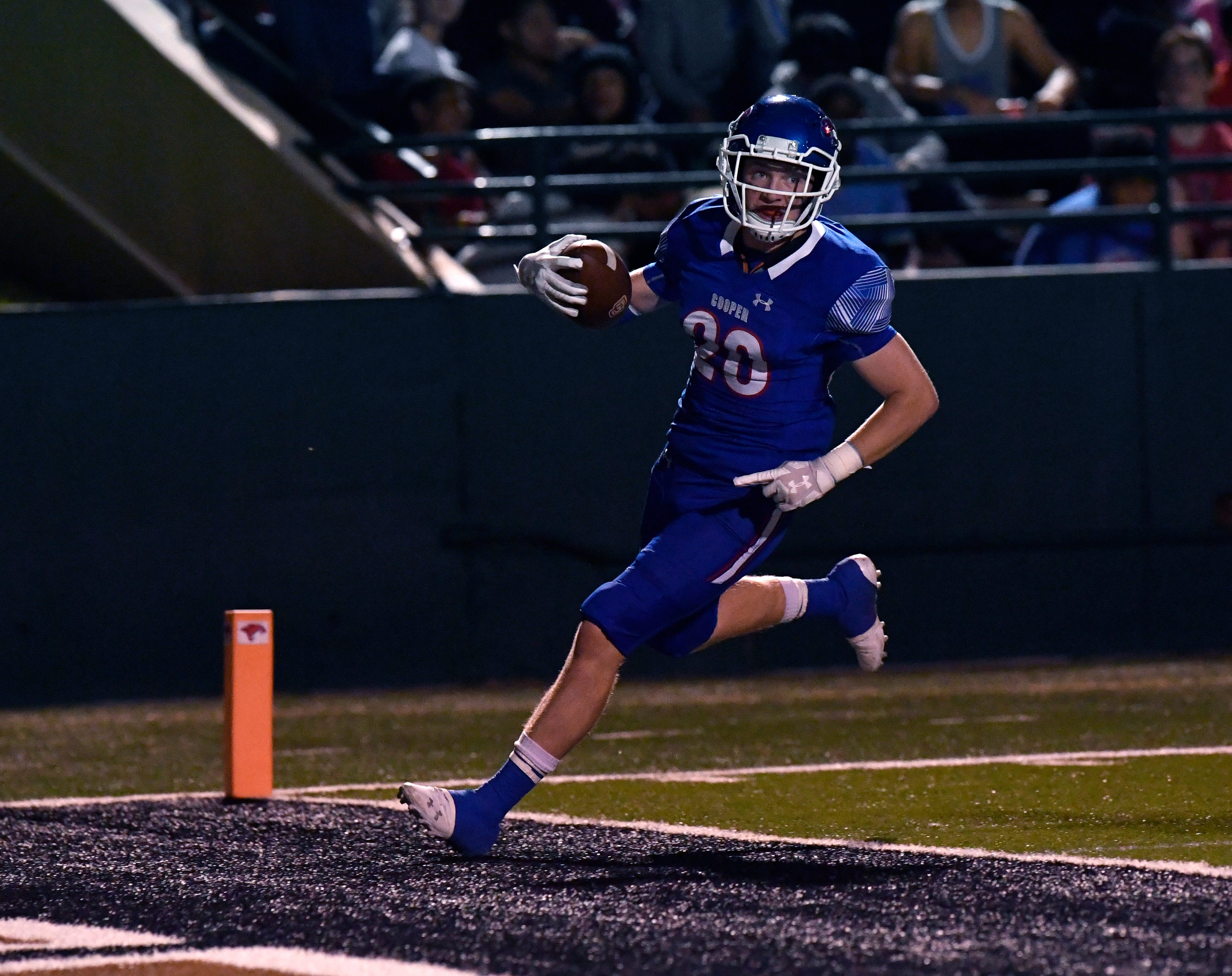 Cooper defensive back Brady Miller scores a touchdown after intercepting a Lubbock Coronado pass and returning it 19 yards. Miller's score helped the Cougars tie the game at 14-14 late in the first quarter. Coronado won the District 2-5A Division I game 42-23 on Friday at Shotwell Stadium.
