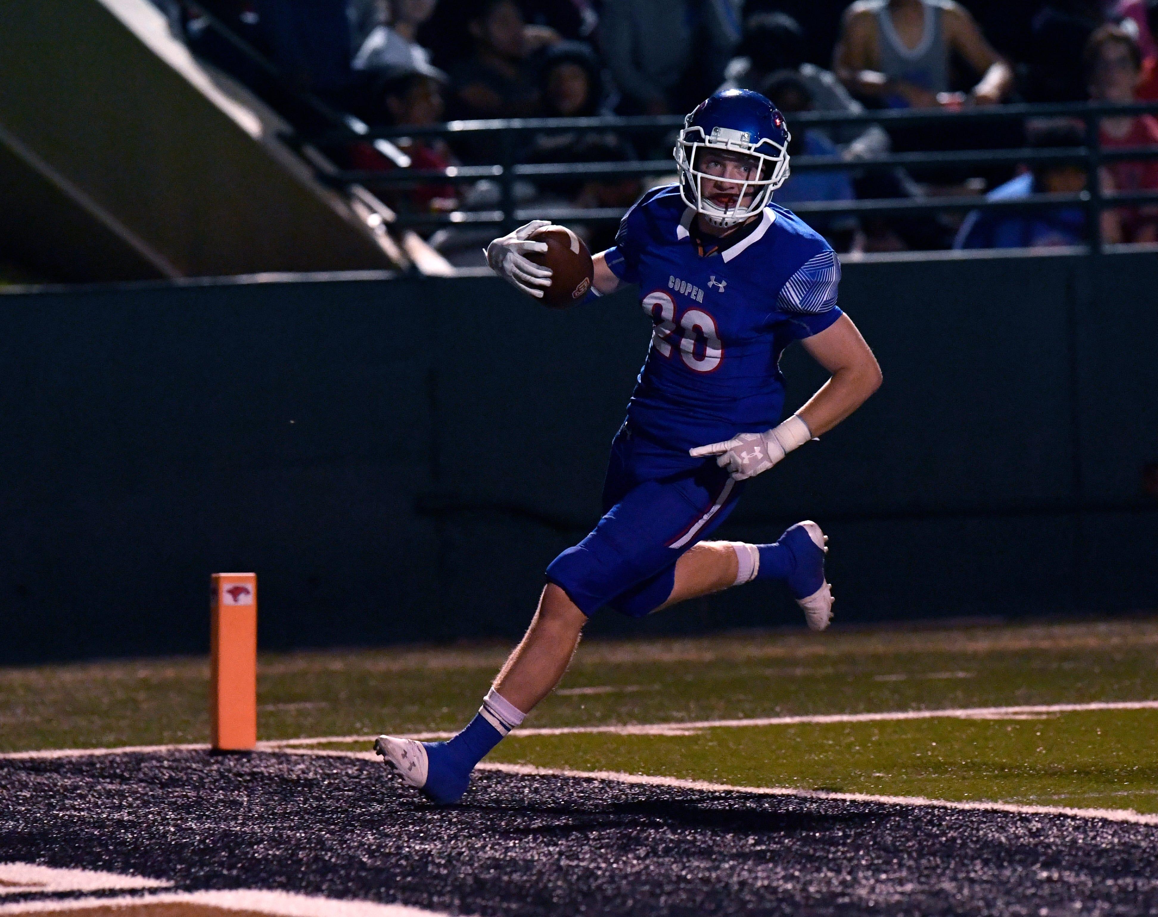 Cooper linebacker Brady Miller scores a touchdown after intercepting a Lubbock Coronado pass on Oct. 5.