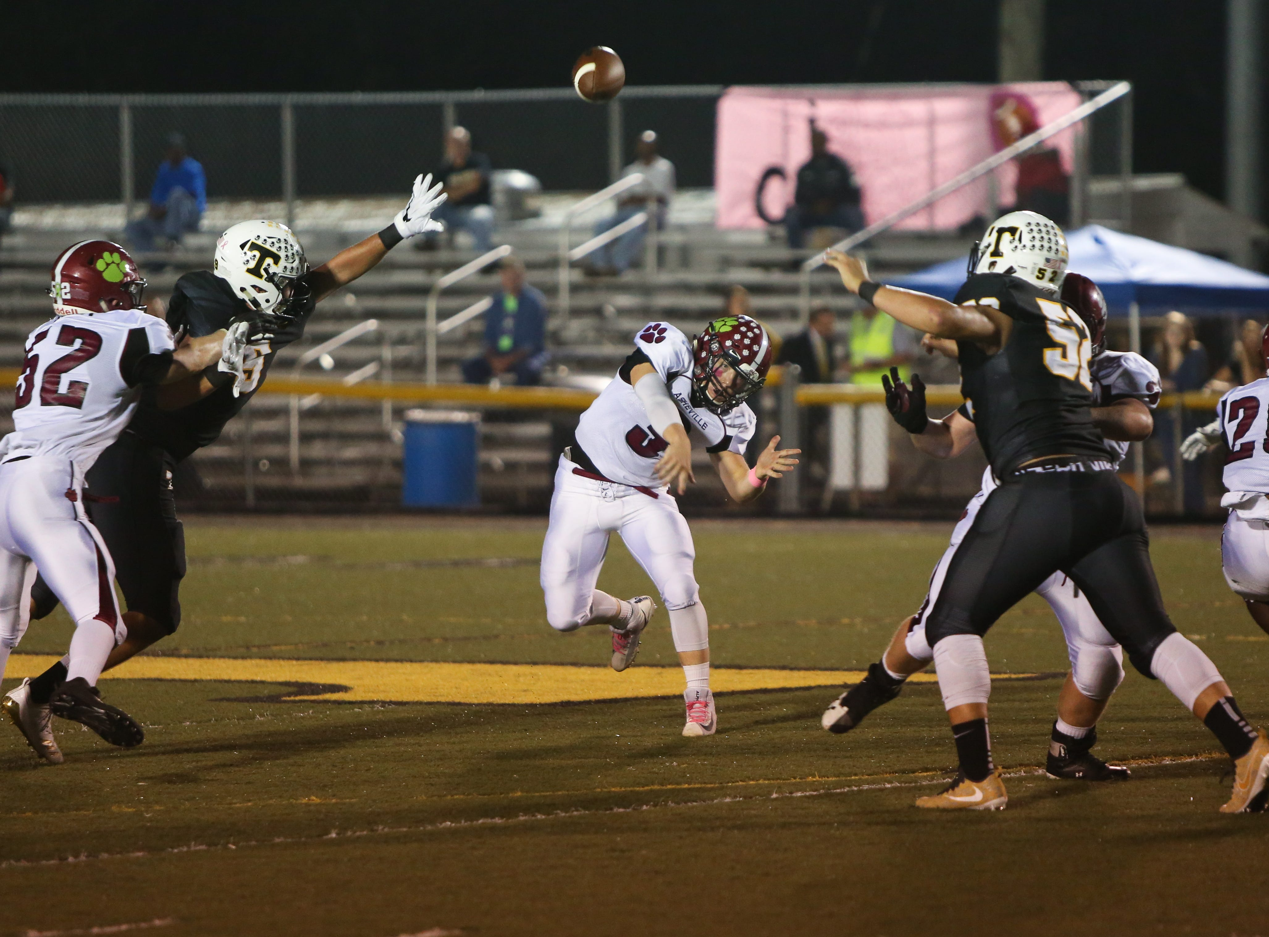 Asheville's Three Hillier throws the ball on Friday, October 5th, 2018 at Tuscola.  Asheville took the win over Tuscola with a final score of 37-6.