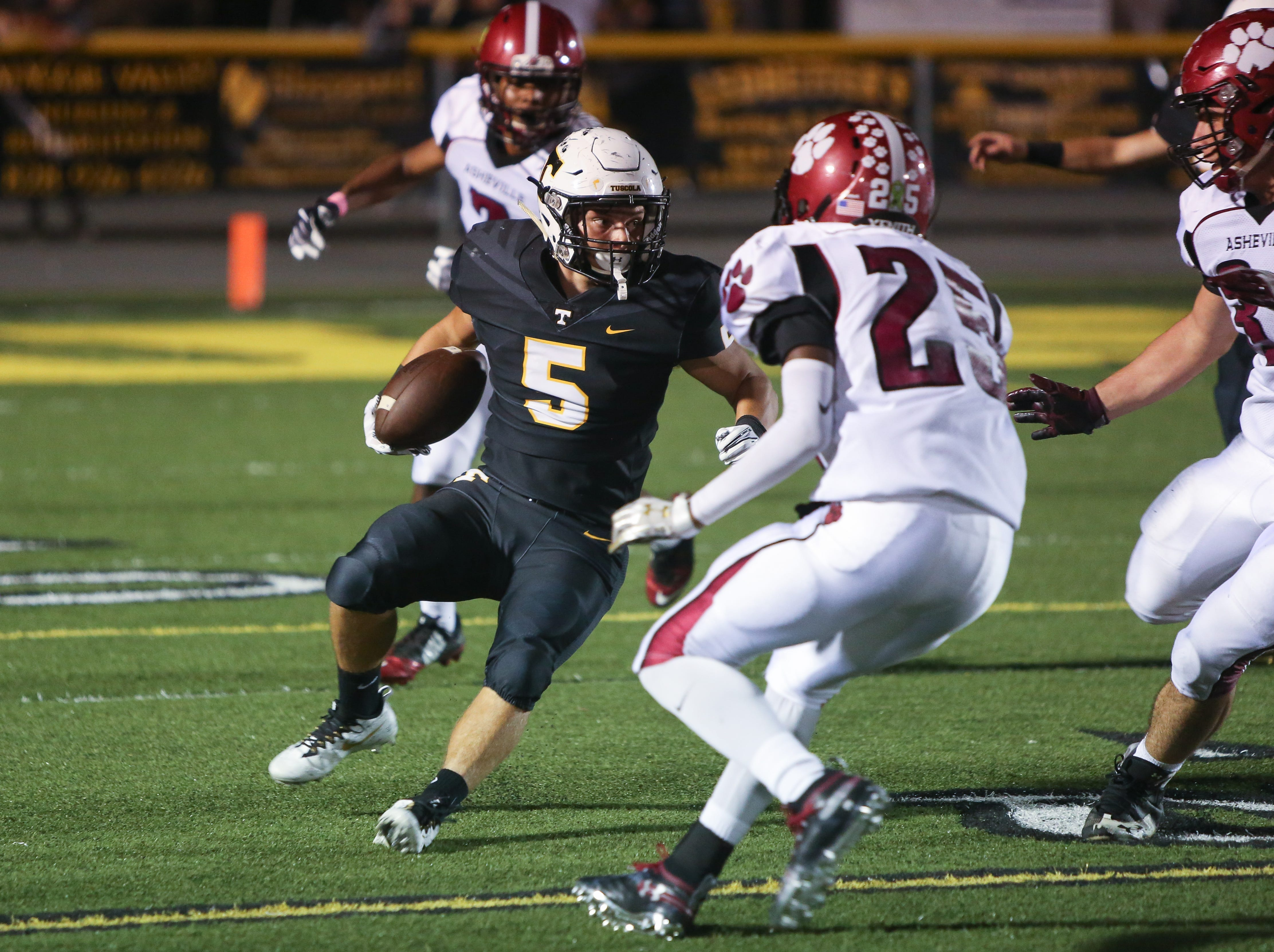Tuscola's Nick Cole runs the ball on Friday, October 5th, 2018 at Tuscola.  Asheville took the win over Tuscola with a final score of 37-6.