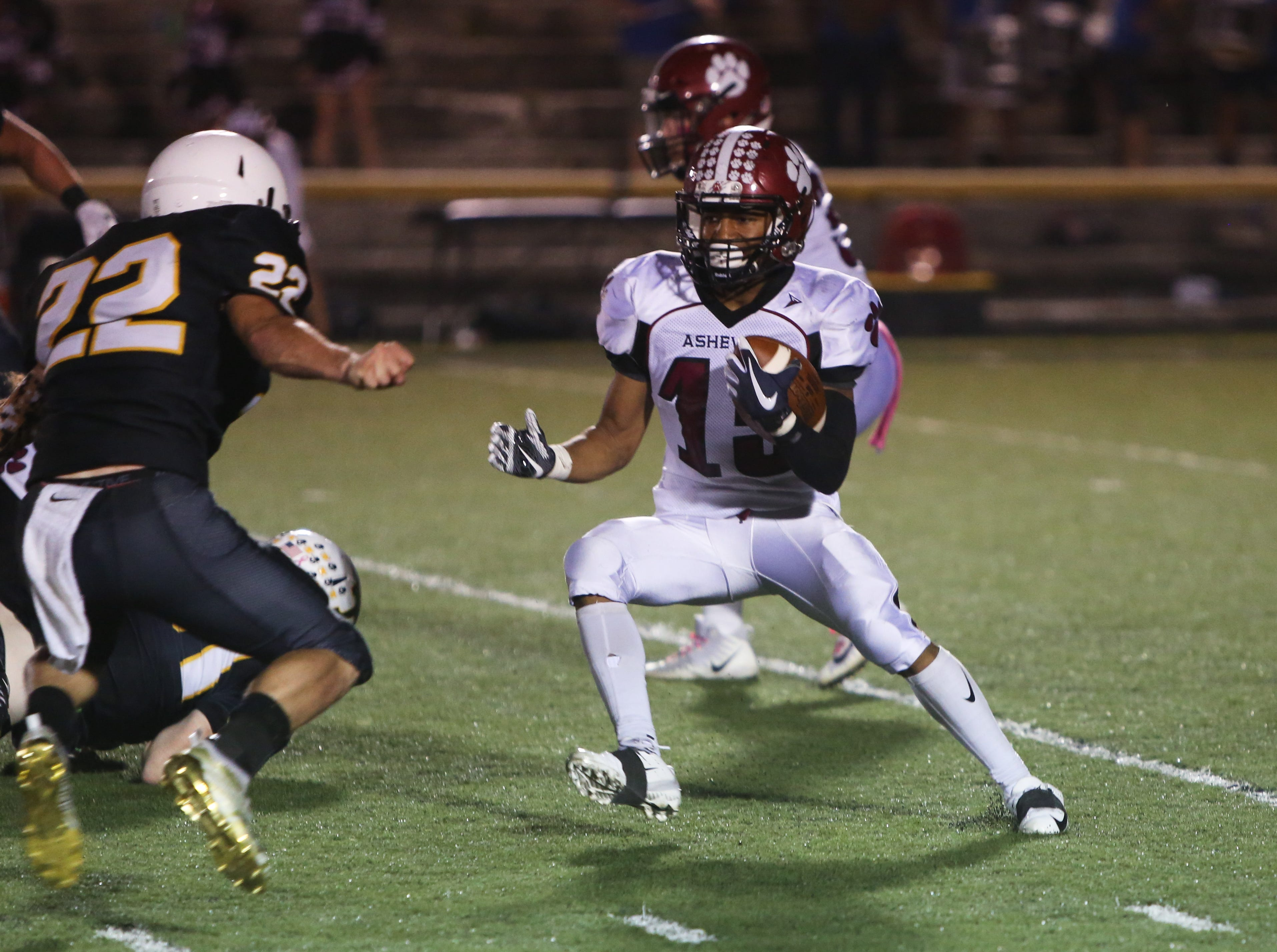 Asheville's Justin Campbell runs the ball on Friday, October 5th, 2018 at Tuscola.  Asheville took the win over Tuscola with a final score of 37-6.
