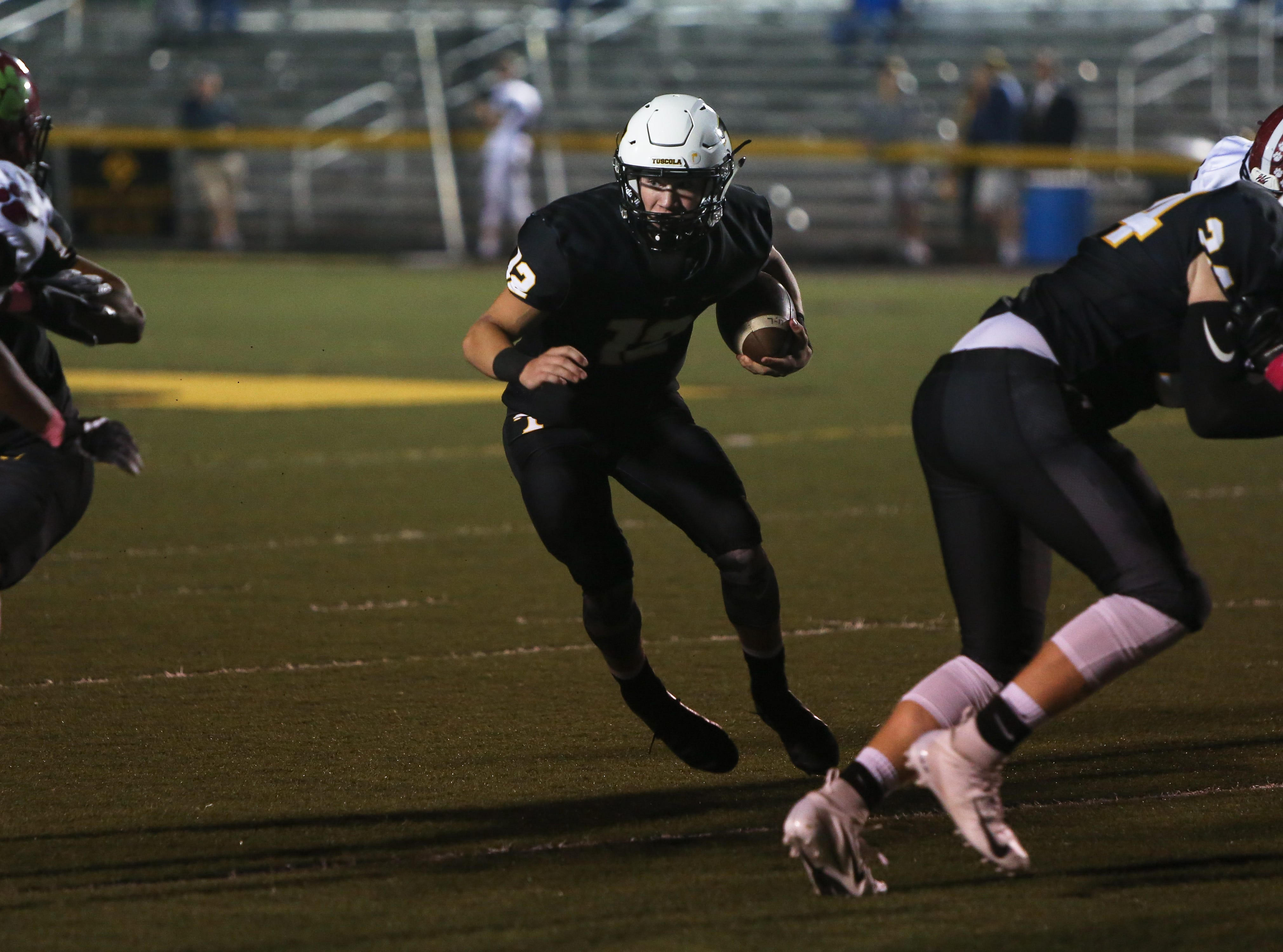 Tuscola's Coleman Bryson runs the ball on Friday, October 5th, 2018 at Tuscola.  Asheville took the win over Tuscola with a final score of 37-6.