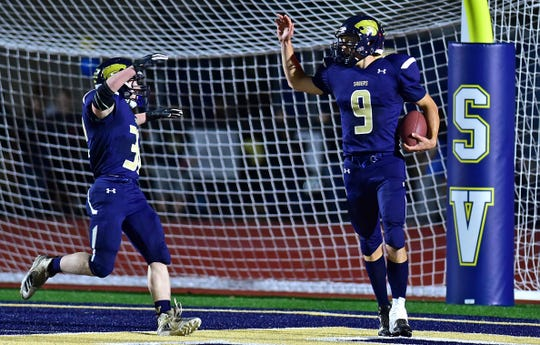 Susquehanna Valley quarterback Jarred Freije celebrates a touchdown against Newark Valley on Oct. 5, the Sabers' first football game on their turf field.