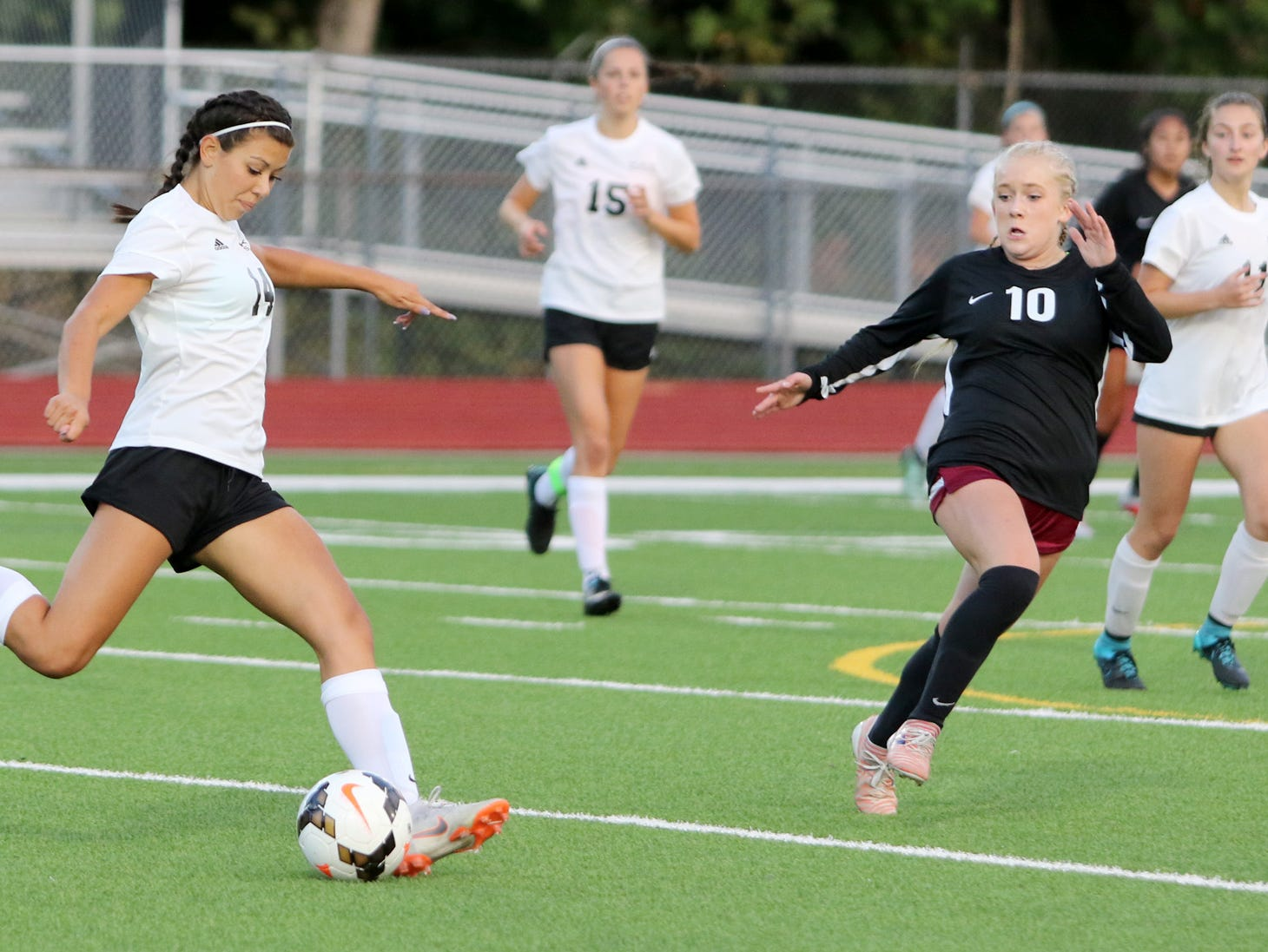 Klahowya's Hailey Connolly boots the ball past South Kitsap's Mackenzie Sinclair.