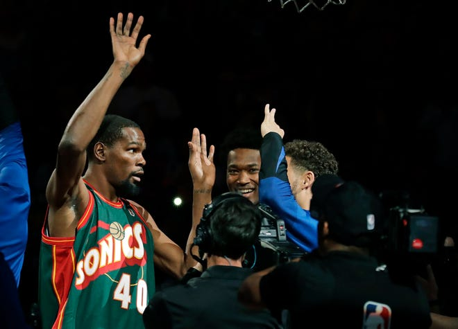 Kevin Durant sported a Shawn Kemp Sonics jersey during pre-game introductions before Friday's NBA preseason game at KeyArena.