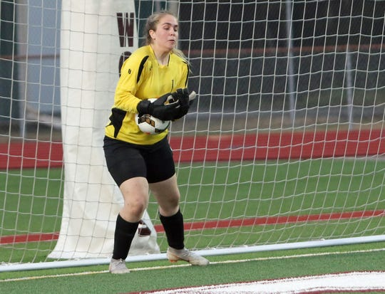 Klahowya goalie Maria Mist makes a save during the first half of a game against South Kitsap. Mist, Klahoywa's starting goalkeeper, is an exchange student from the soccer-crazed country of Iceland.