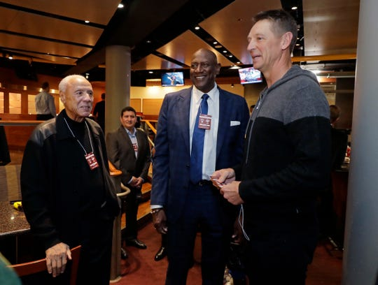 Former Sonics, from left, Lenny Wilkins, Spencer Haywood and Detlef Schrempf talk before Friday's preseason game at KeyArena.