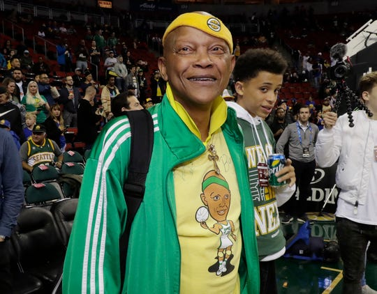 Sonics legend Slick Watts stands courtside before Friday's game.