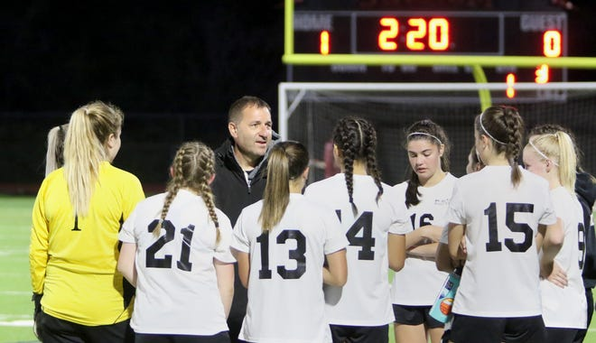 Klahowya girls soccer coach Troy Oelschlager and the Eagles will play in the Class 1A state semifinals Friday against King's Way Christian. Klahowya is seeking its third state title in school history.