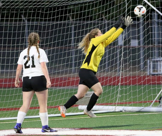 Klahowya keeper Maria Mist saves a shot on goal during the second half of a game this fall against South Kitsap. Mist's presence as an exchange student solidified a potential weakness for the Eagles, who are again Class 1A contenders.