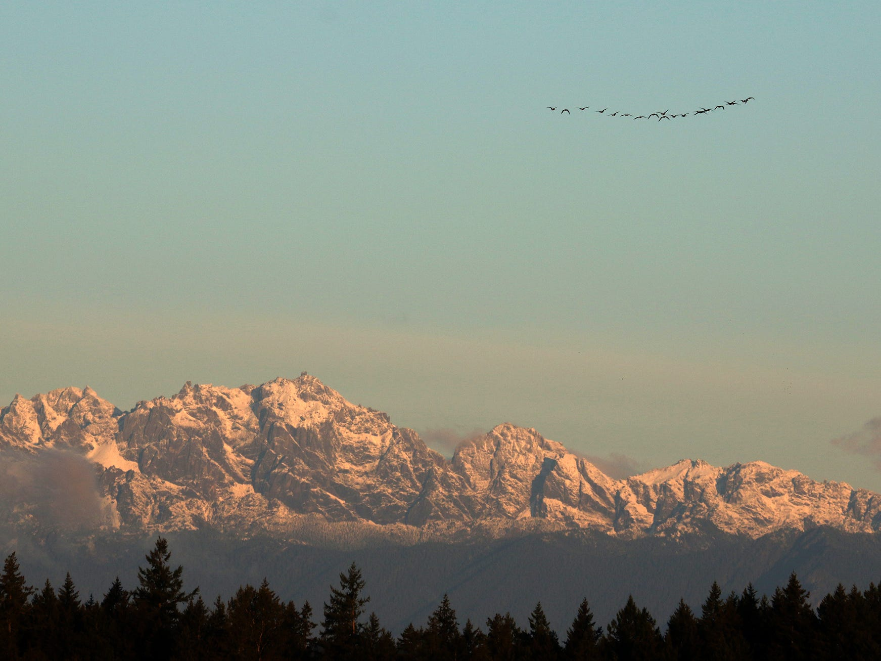 Snow covers the tops of the Olympic Mountains as seen from East Bremerton on Saturday, October 6, 2018.