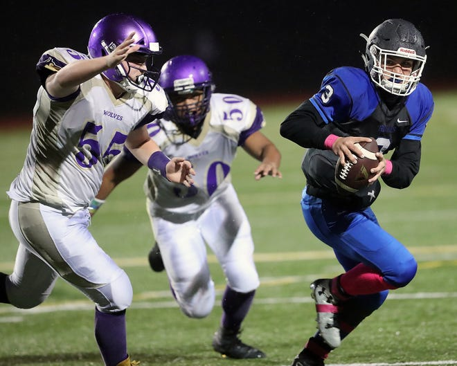 Olympic quarterback Zeke Gillick (right) and the Trojans host Bremerton in the Kitsap Sun Week 8 Game of the Week on Friday at Silverdale Stadium.