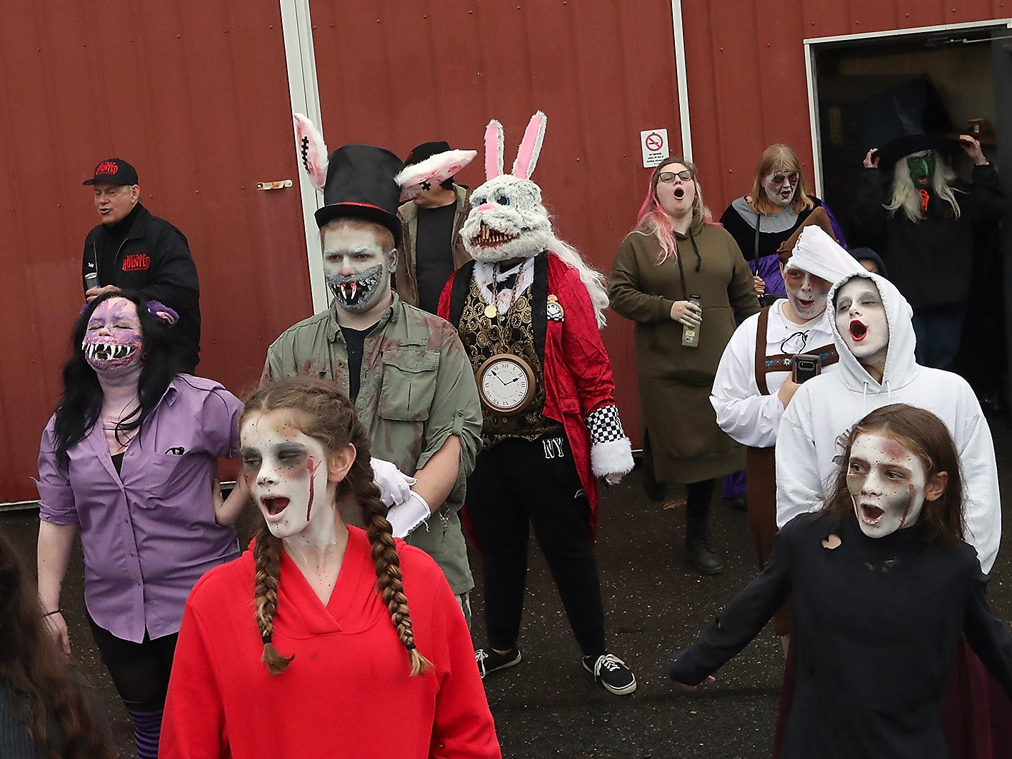 The cast and crew of the Kitsap Haunted Fairgrounds give a howl as they prepare to take their positions for opening night on Friday, October 5, 2018.