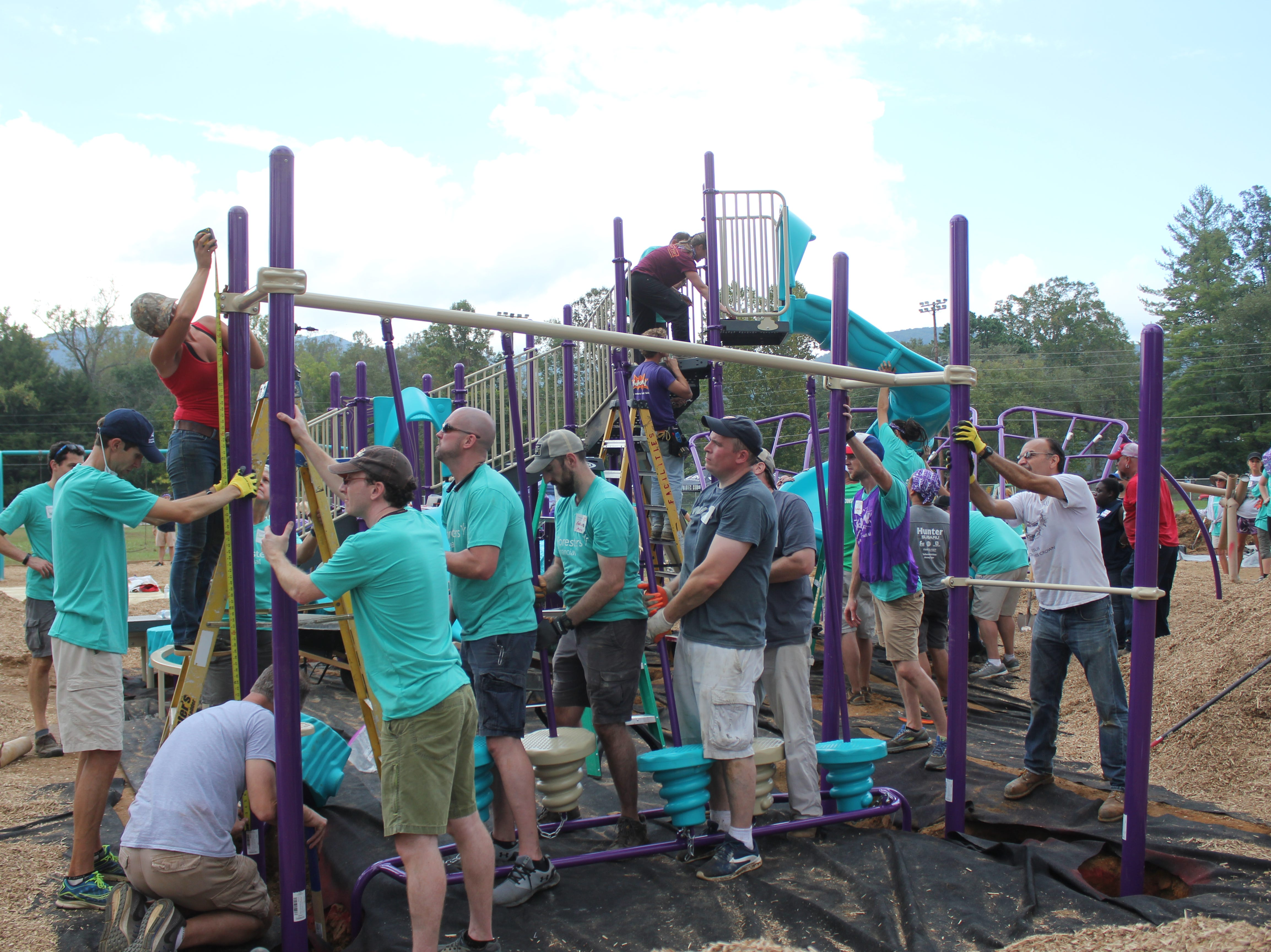 Over 200 volunteers showed up at Black Mountain Primary School on Saturday, Oct. 6 to construct a KaBOOM! playground. The project was made possible through a Build it With KaBOOM! grand, which was funded by Forester Financial. The YMCA of Western North Carolina and Black Mountain Primary partnered to apply for the grant, which they were awarded earlier this year.