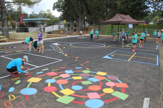 Around 250 volunteers helped build the new playground at Black Mountain Primary School on Oct. 6.