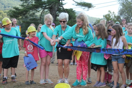 Black Mountain Primary School principal Malorie McGinnis cuts the ribbon with students for a brand new playground on Oct. 6.